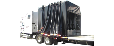 "Our Rolling Tarp ""Covered Wagon"" will take care of your hauling needs."